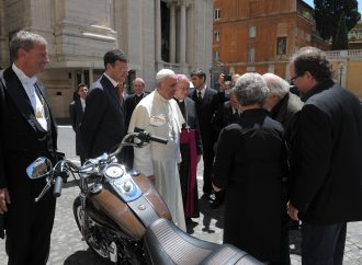 Pope's Harley brings $404,500 for charity at auction