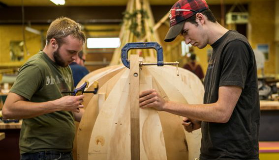 Kris Kindt and Matthew Edmondson gets hands-on study at Great Lakes Boat Building School