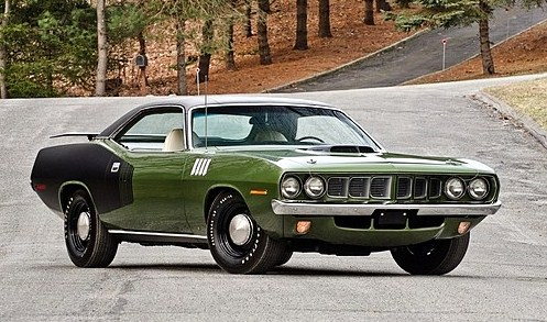 The Hemi Cuda is fitted with 4-speed stickshift | Mecum Auctions