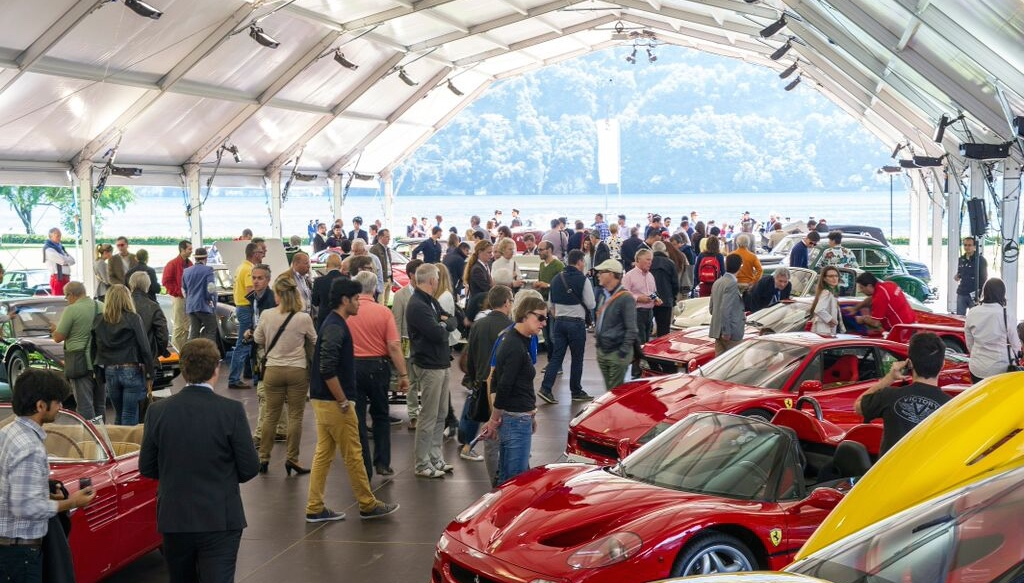Bidders and spectators take a close look at the cars