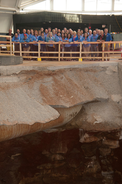 Museum staff views the sinkhole