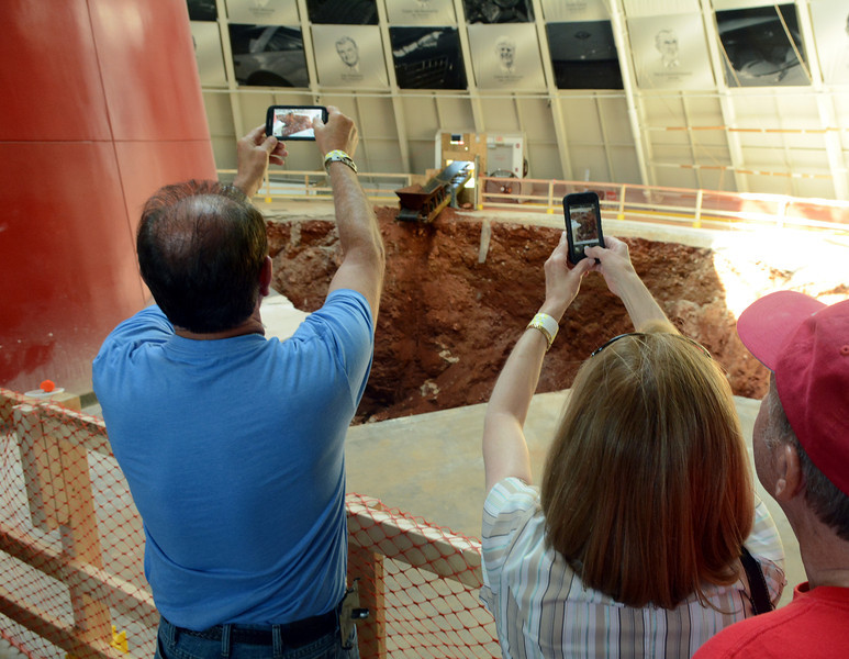 Visitors photograph the sinkhole | Corvette National Museum photos
