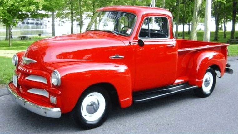 The five-window Chevy pickup looks well-finished in its bright-red paint job