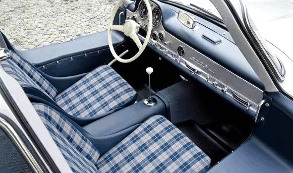 The car is outfitted with a blue-plaid interior | Gooding