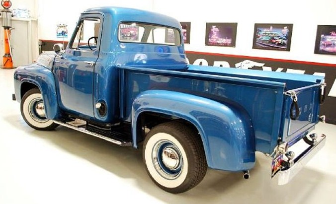 The step-side truck body shines in metallic blue