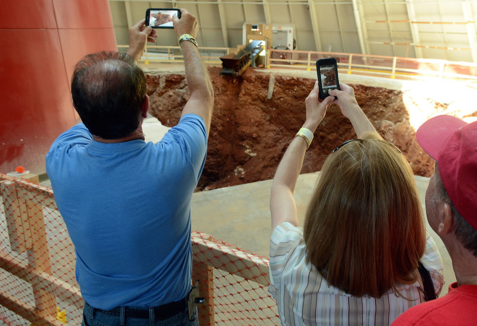 Visitors photo the hole beneath the Skydome