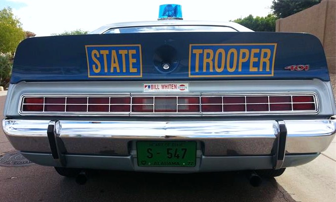 The rear wing accommodates the 'State Trooper' lettering