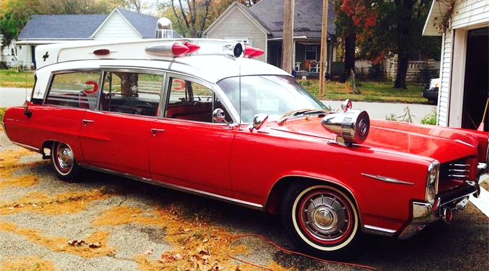 The 1964 Pontiac Bonneville ambulance has a huge siren apparatus mounted on its fender