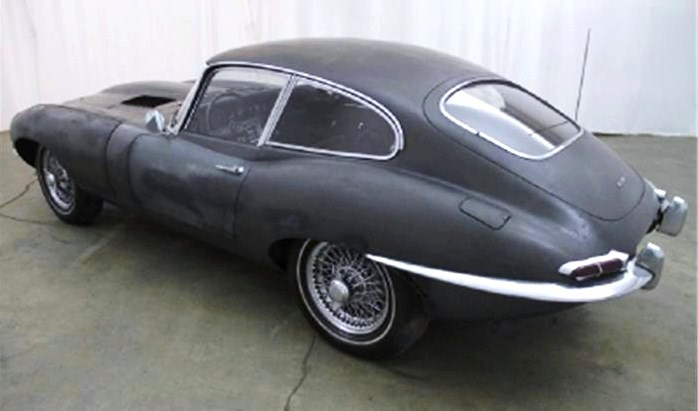 The E-type looks luscious despite its grungy paint