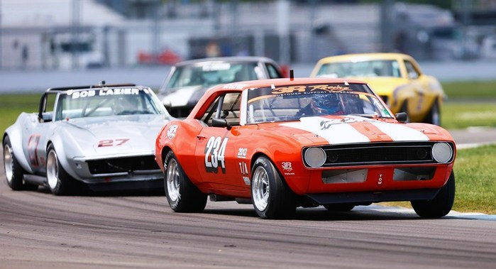 Chevys battle for the lead during last year's SVRA Brickyard Racing Invitational | Indianapolis Motor Speedway