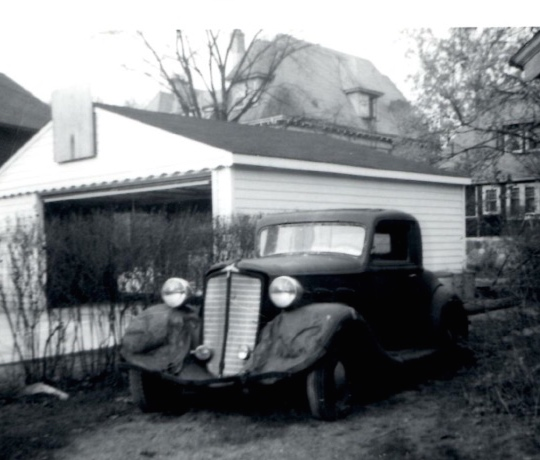The REO sitting next to the garage.