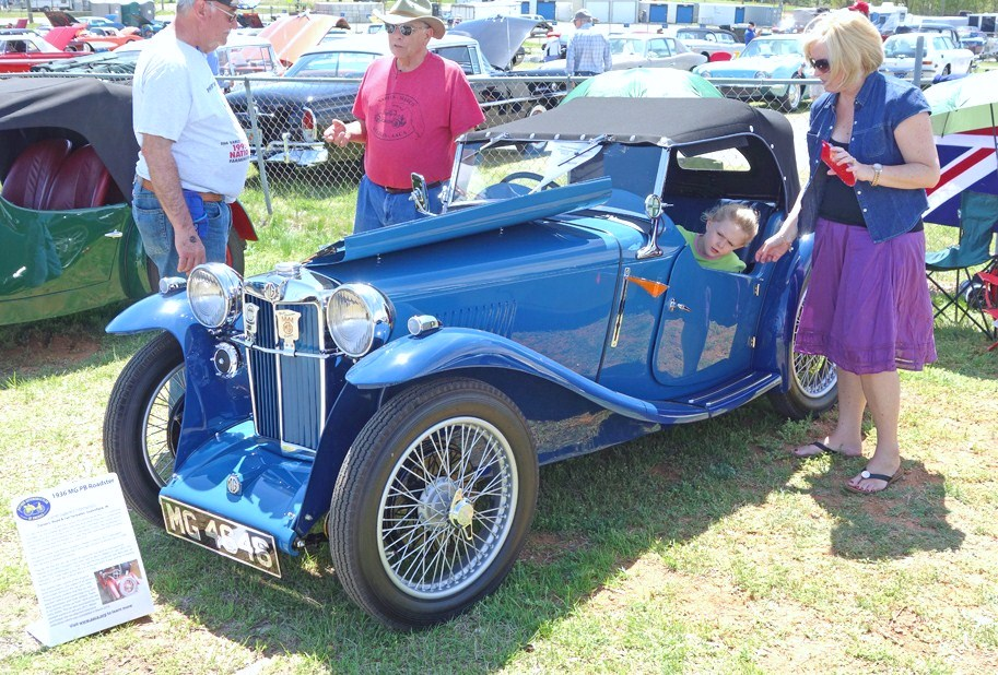 Family gathering around a 1936 MG PB roadster at AutoFair | Andy Reid photos
