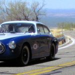A Shelby GT350 chases 1952 Cunningham C-3 coupe