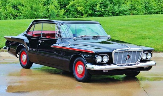 The Plymouth Valiant has been restored to original, the seller says