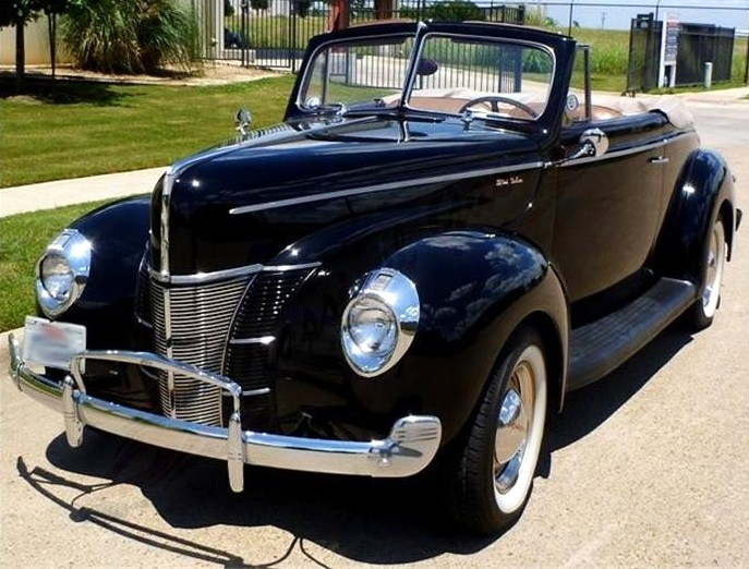 The restored-to-original Ford convertible looks sleek in glossy black