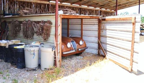 The Jaguar XK120 takes a rare peak outside its little tin shed