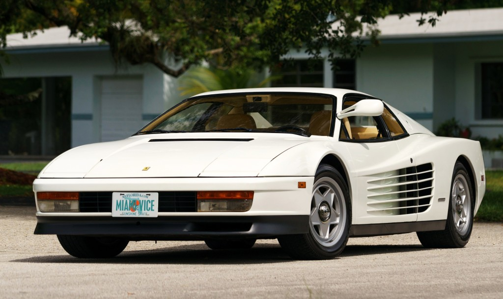 The Ferrari Testarossa is an early model with a single rear-view mirror | Mecum