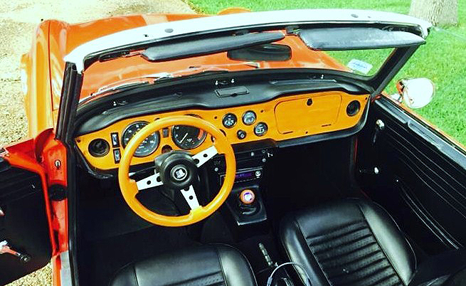 The interior features a real-wood dashboard