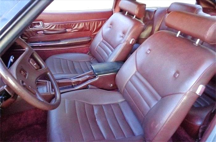 The 'burgundy maroon' interior is a throwback to the disco days