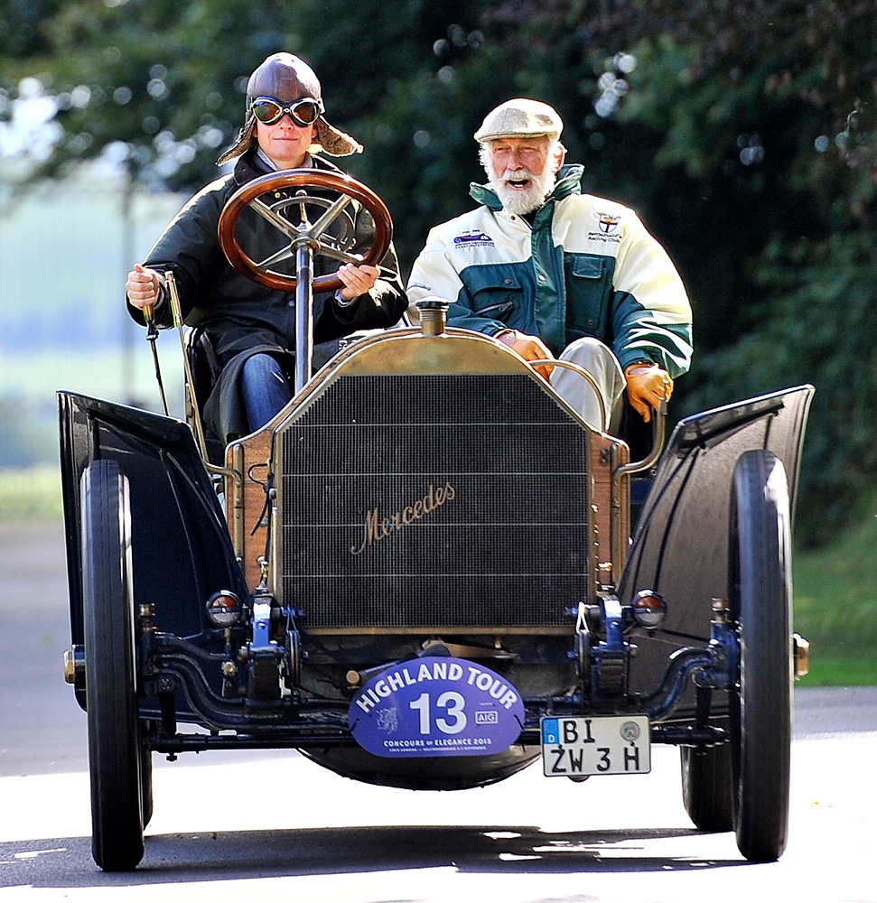 Concours host, Prince Michael of Kent, takes a ride in the best of show-winning Mercedes