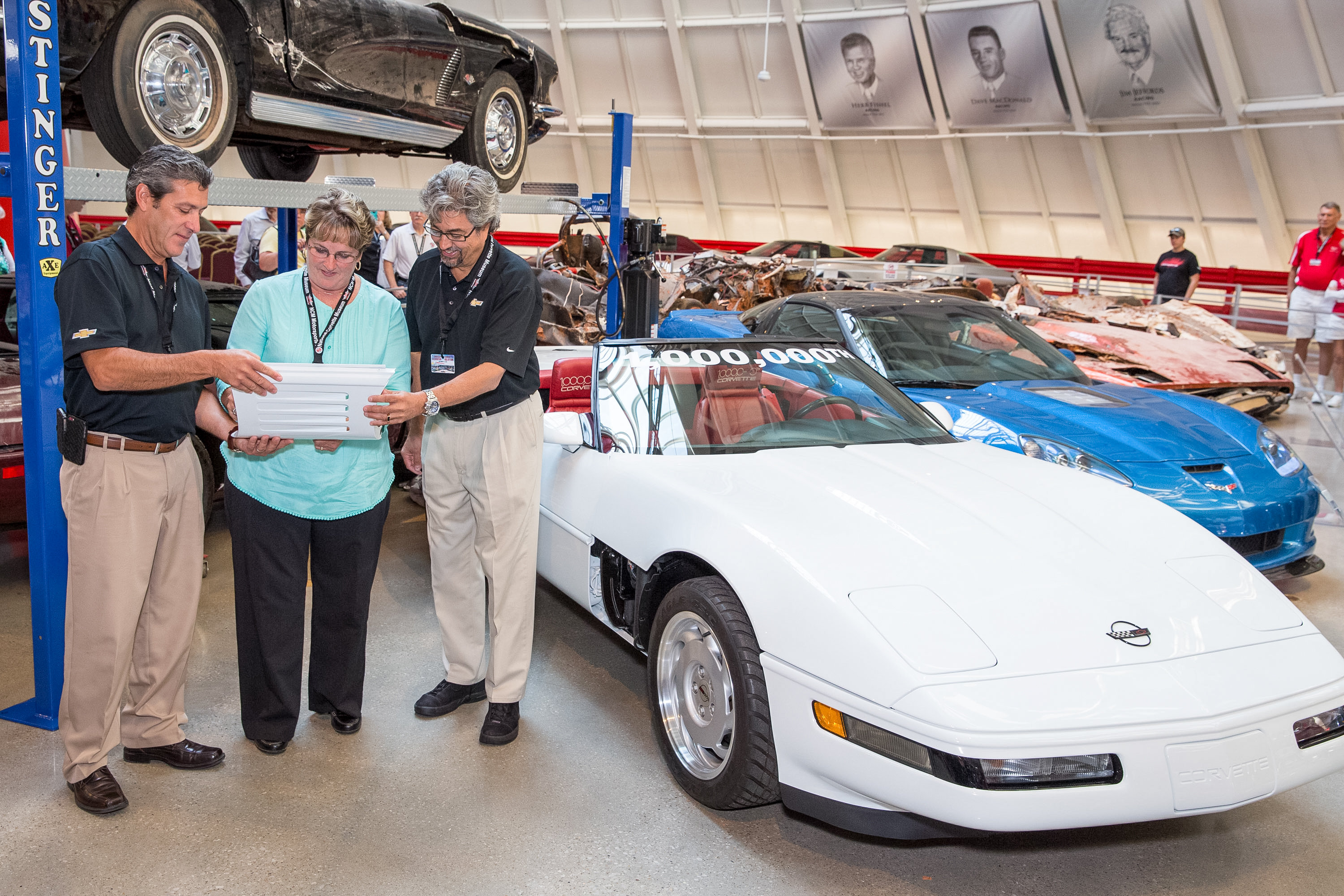 With David Bolognino and design stafferJohn Cafaro on hand, Angela Lamb adds her signature to the final panel needed to restore the 1 Millionth Corvette | Chevrolet photos by John F. Martin