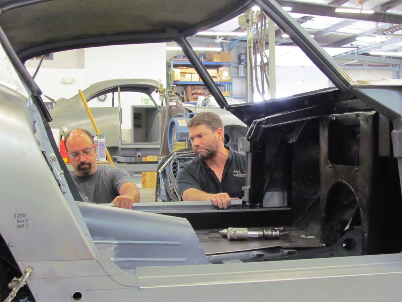 Andy Gemmete (left) and Hans Sahling fashion new rocker panel for the 250GT
