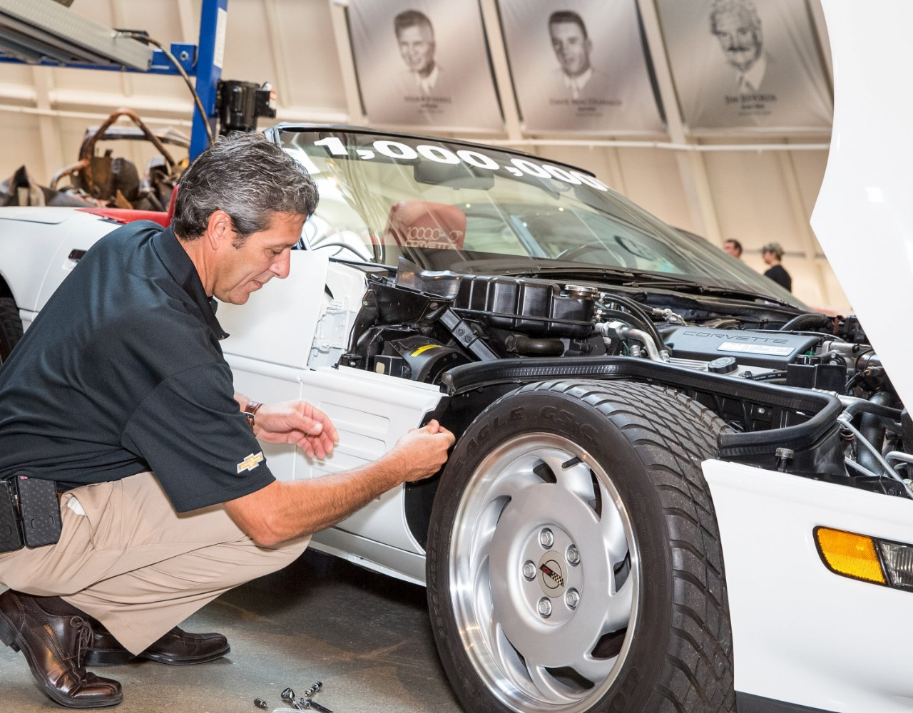 David Bolognino, director of GM Global Design Fabrication Operations, secures the final panel to the car