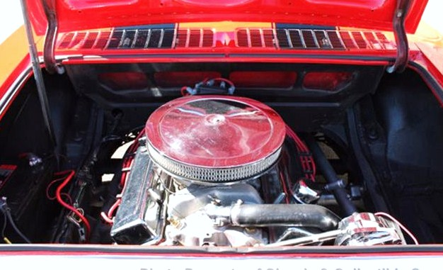 The V8 seems to fit nicely in the Corvair's rear engine compartment