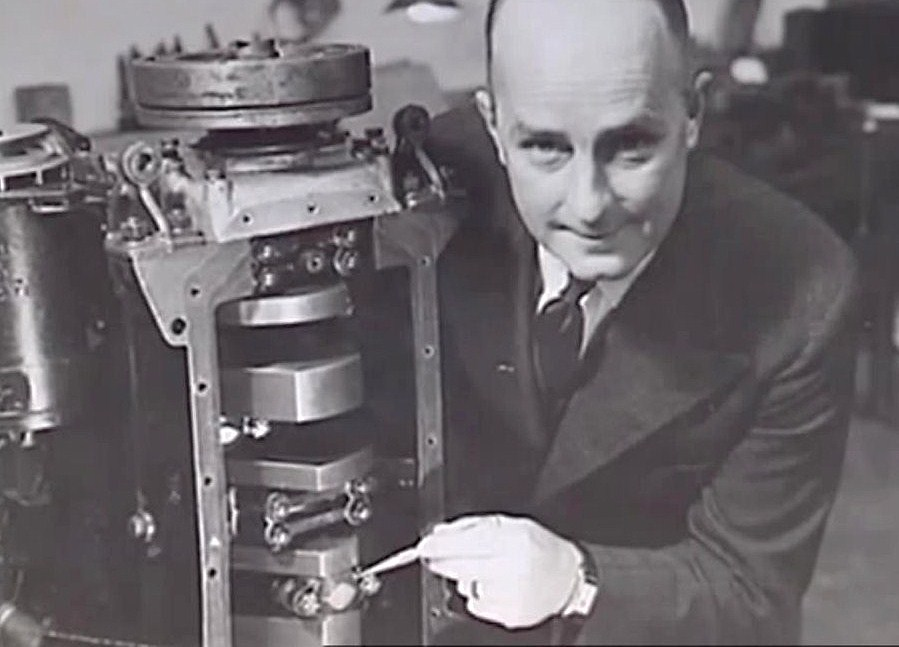 Donald Healey, wearing the Rolex, shows an engine at the Triumph factory during the 1930s | Bonhams photo