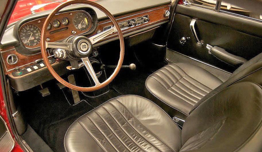 The Lancia interior looks lush, original and comfortable
