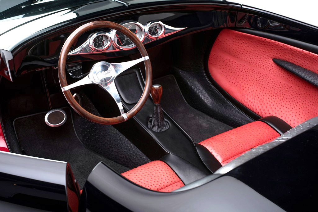 The interior is trimmed in ostrich leather