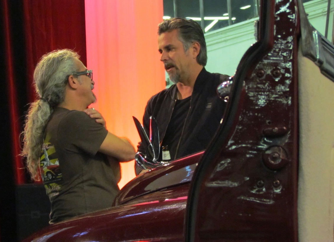 Rawlings (right) chats with St. Louis-area classic car dealer Scott Brandt of Motoexotica
