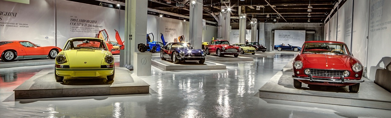 The auction showroom put each car on a pedestal