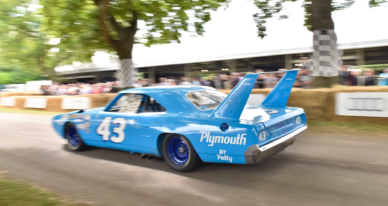 Richard Petty's historic Plymouth heads up the hill at 2015 Goodwood Festival of Speed |Goodwood photos