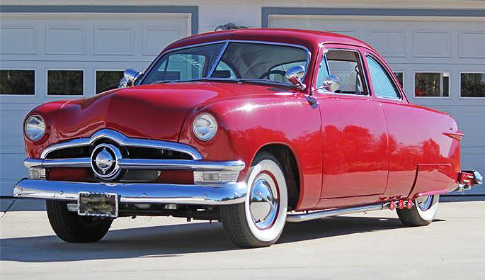 The 1950 Ford coupe has been customized in the style of an old-school cruiser