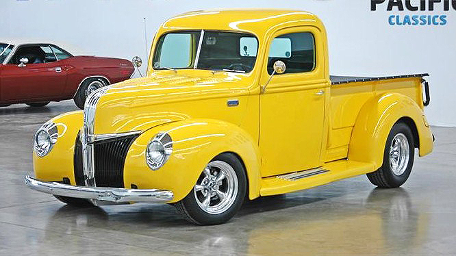 The bright-yellow 1941 Ford custom pickup looks like a Christmas toy
