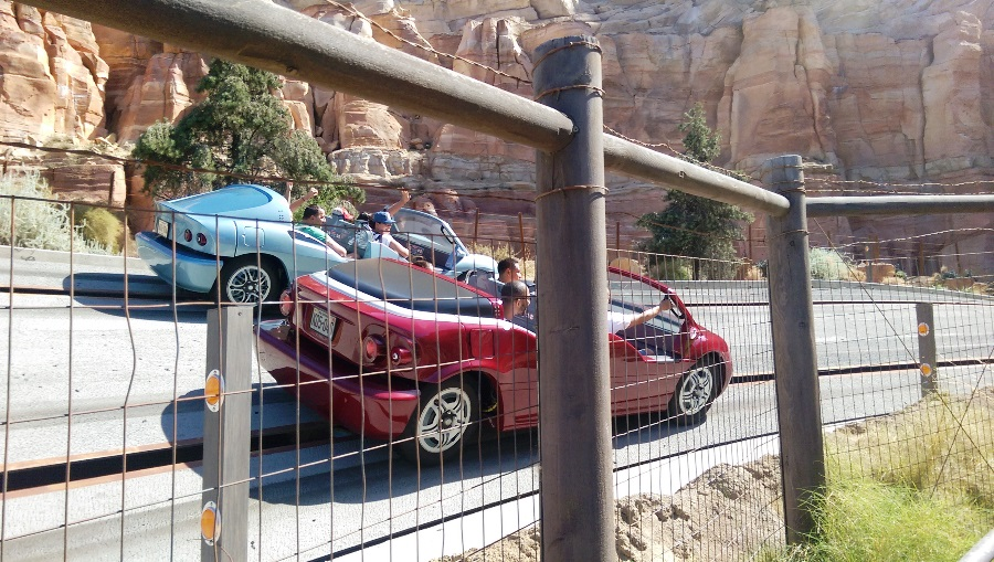 Two cars drag racing on the ride