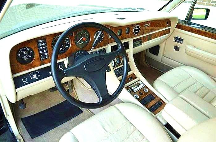 The Bentley interior is rich with genuine wood and leather features