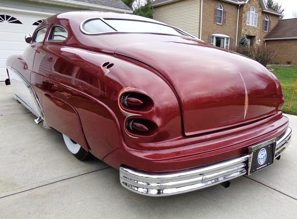 Frenched taillights and antennas highlight the Mercury's rear fenders