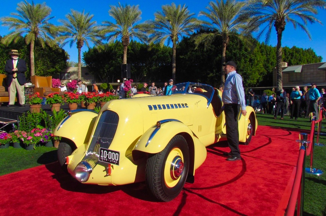 John Carefoot stands next to the 1935 Duesenberg SJ Special on the red carpet at the Arizona Concours d'Elegance | Larry Edsall photos