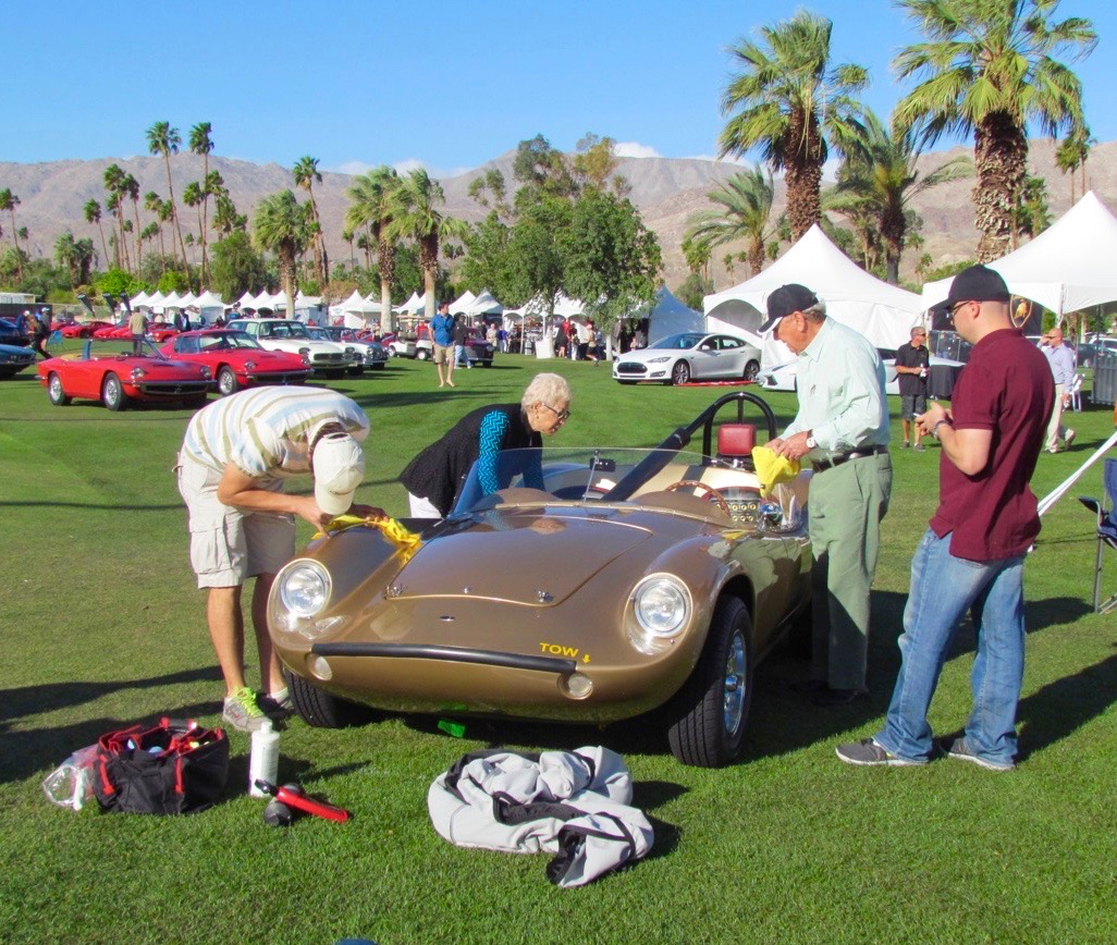 Her hair white from chemo, Stephanie helps clean the 1959 Devin C at 2014 Desert Concorso