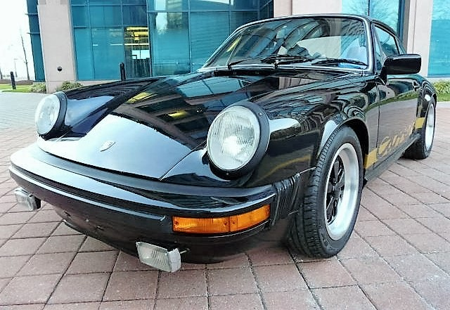 A 1974 Porsche 911 Carrera, black with a black-leather interior, is the earliest car in the auction | LiveAuctioneers.com