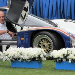 Hans Stuck arrives  at the podium in the 1986 Le Mans-winning  Rothmans Porsche 962C