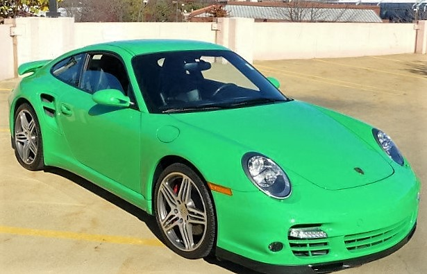 A bright-green 2009 Porsche 911 Turbo has just 13,742 miles on its odometer