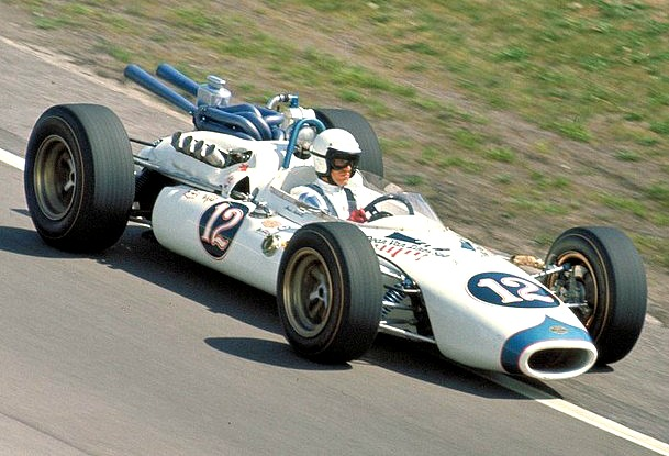 Mario Andretti drive's the rear-engine Brawner Hawk at Indianapolis in 1965 | Ford Motor Co.