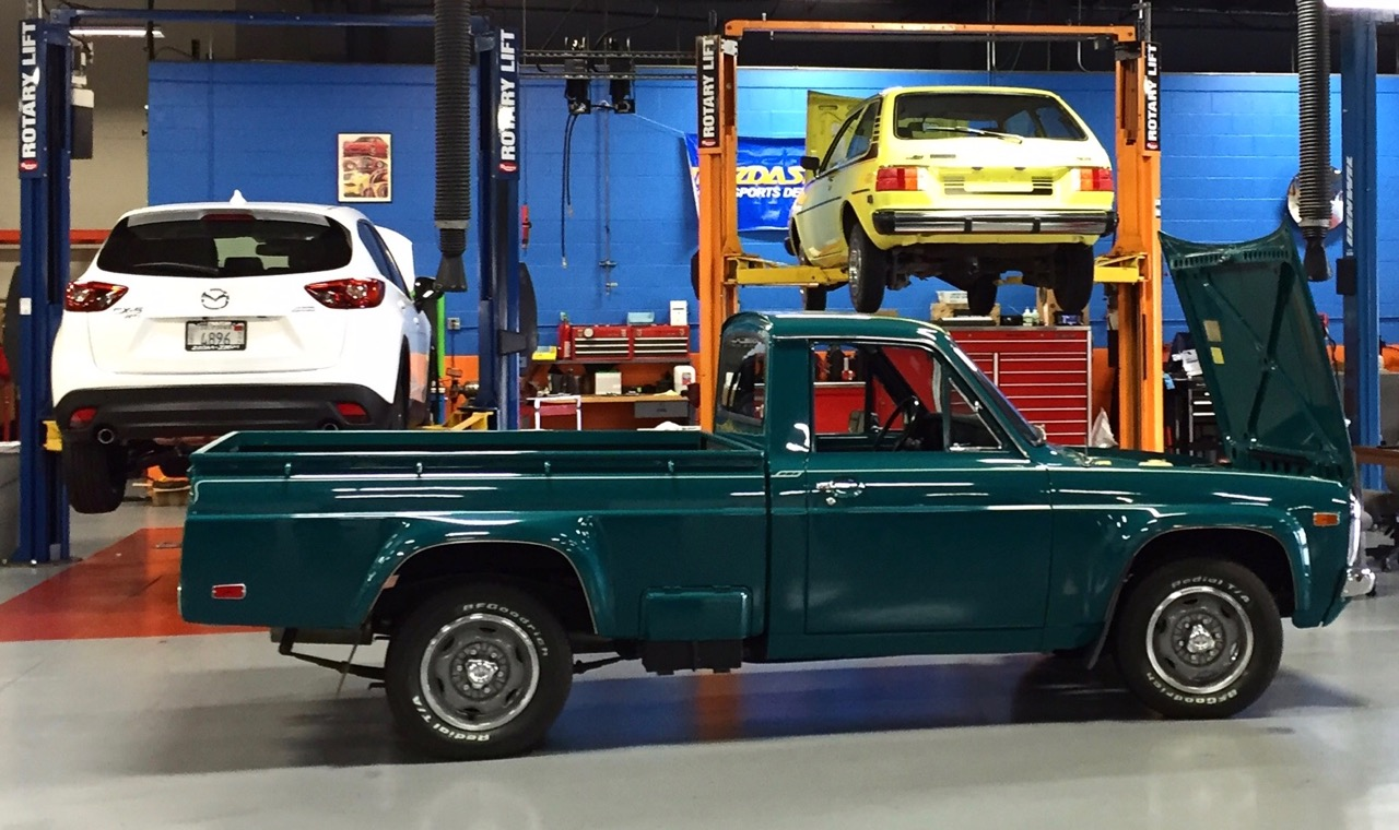 Rotary-engined 1975 Mazda pickup prepped for the rally in corporate museum garage | Mazda photo