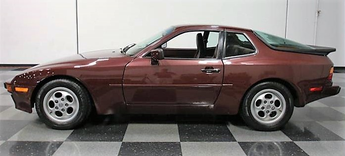 The Porsche 944 has been repainted in its original burgundy