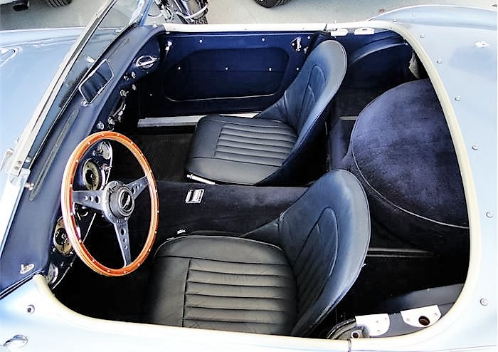 The Healey's cockpit retains its two-seat roadster configuration