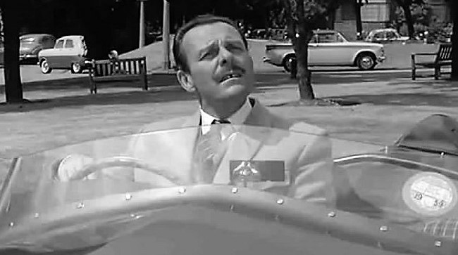 Comedian Terry-Thomas at the wheel of the 'Bellini' in the 1960 film 'School for Scoundrels' | Guardsman FIlms
