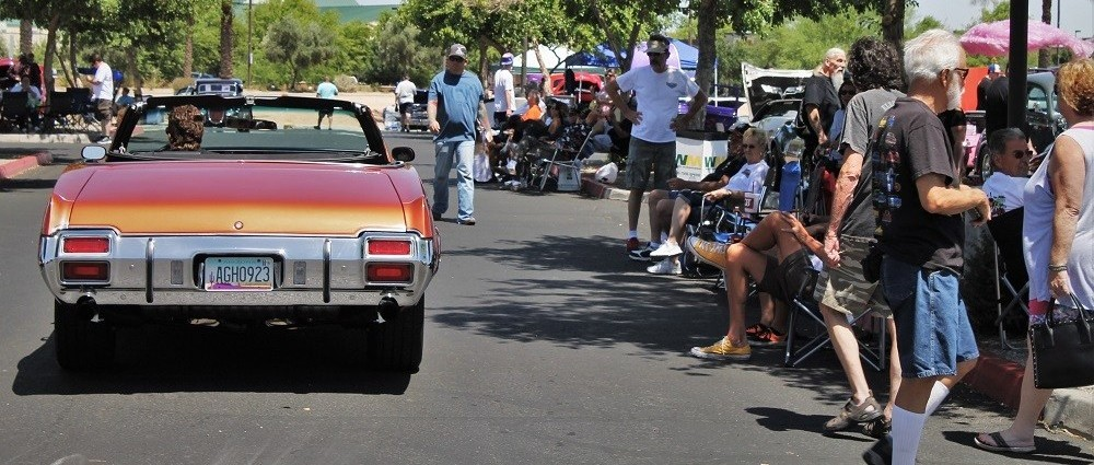 Spectators watching cars park in the show